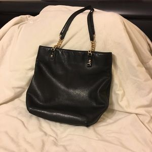 Micheal Kor purse with gold chain on straps.